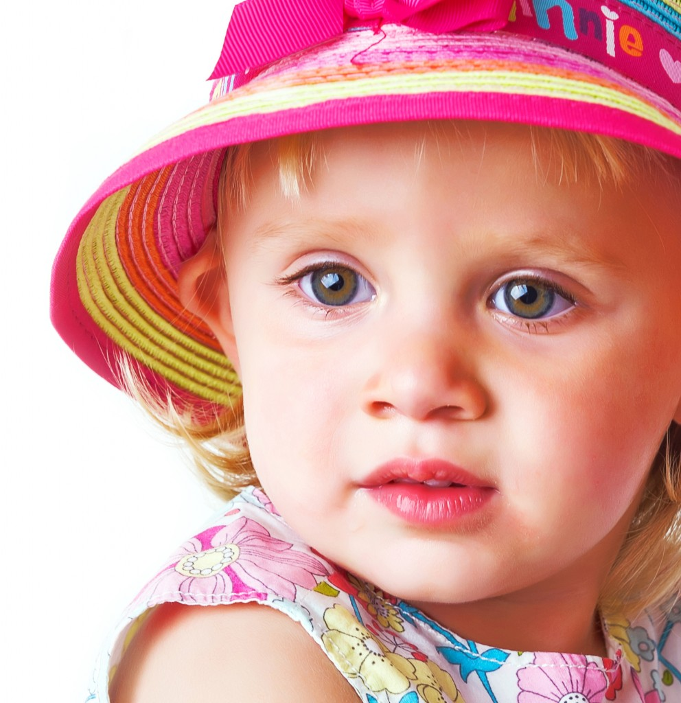Toddler in a colourful hat
