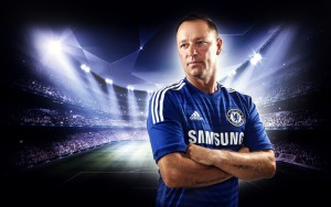 A man in a Chelsea shirt with stadium backdrop