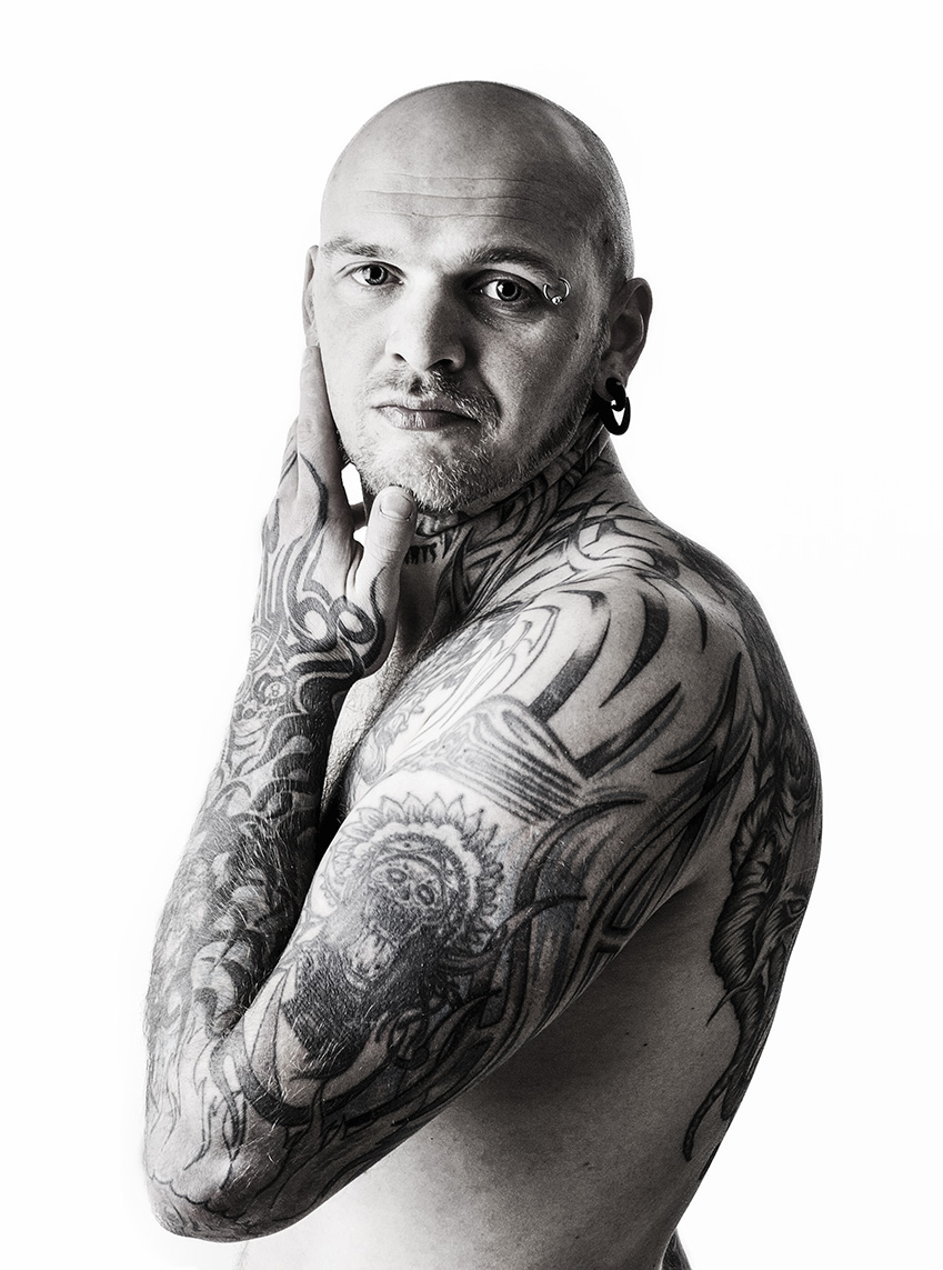 A man showing his tattoos