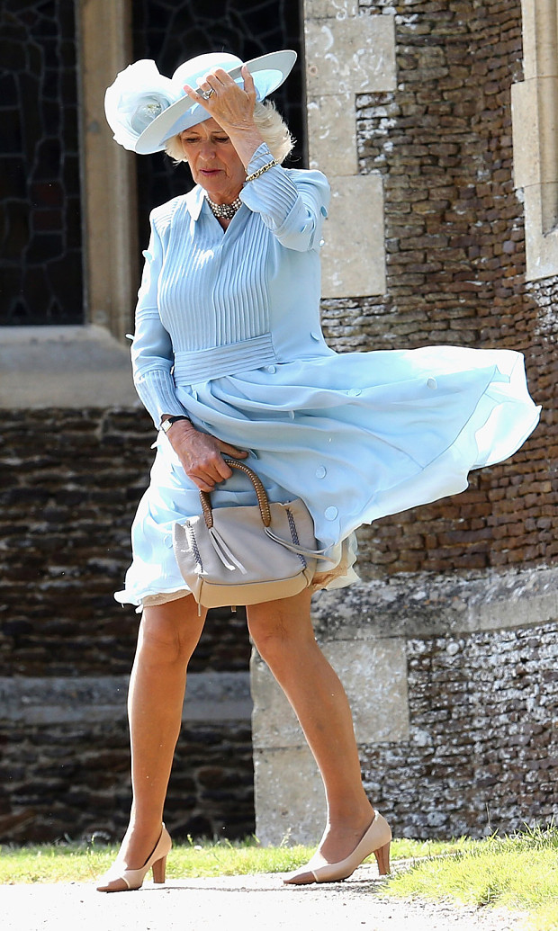 The Duchess of Cornwall has a Marilyn Monroe moment at Princess Charlotte's christening