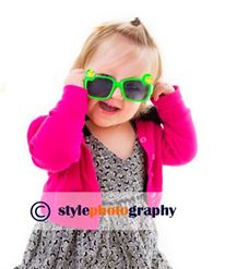 A toddler wearing sunglasses