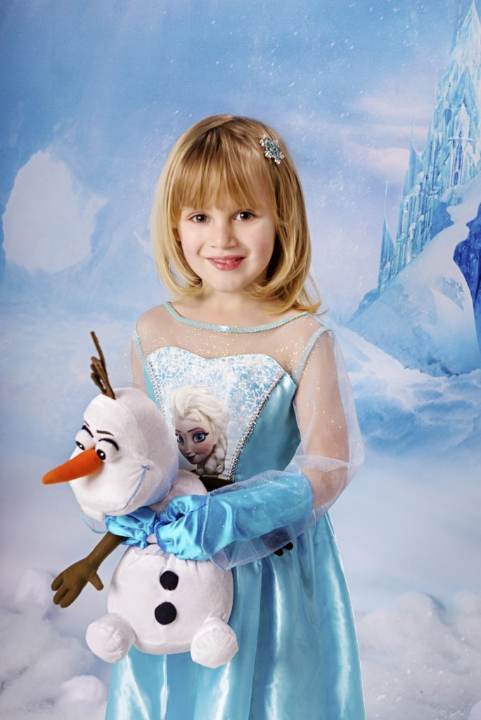 A little Elsa with Olaf the snowman