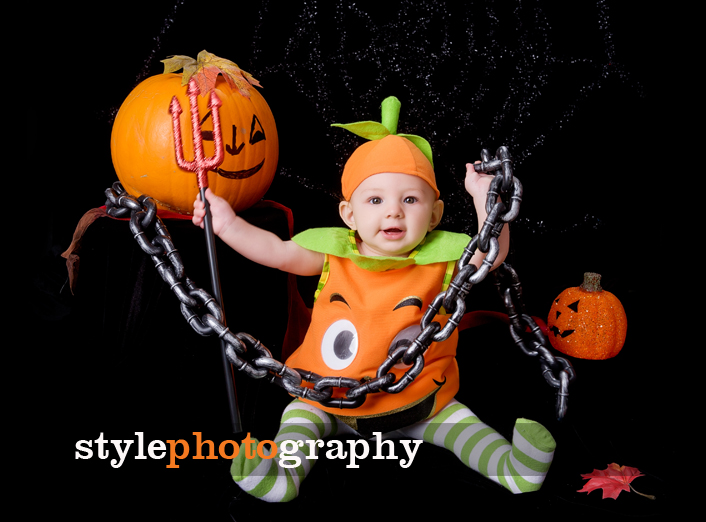Baby dressed as pumpkin