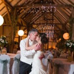 The bride and groom share a kiss at their Winters Barn wedding